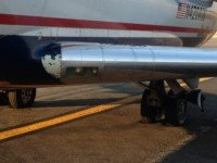 US Airways plane sinks into runway when tarmac softens in extreme heat. Photo credit: Phillip Dugaw